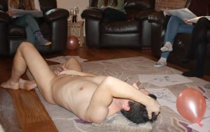 laying down holding penis